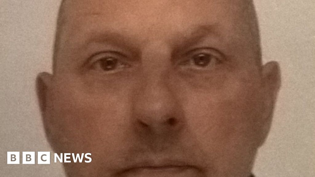 Man wanted over crossbow murder found dead