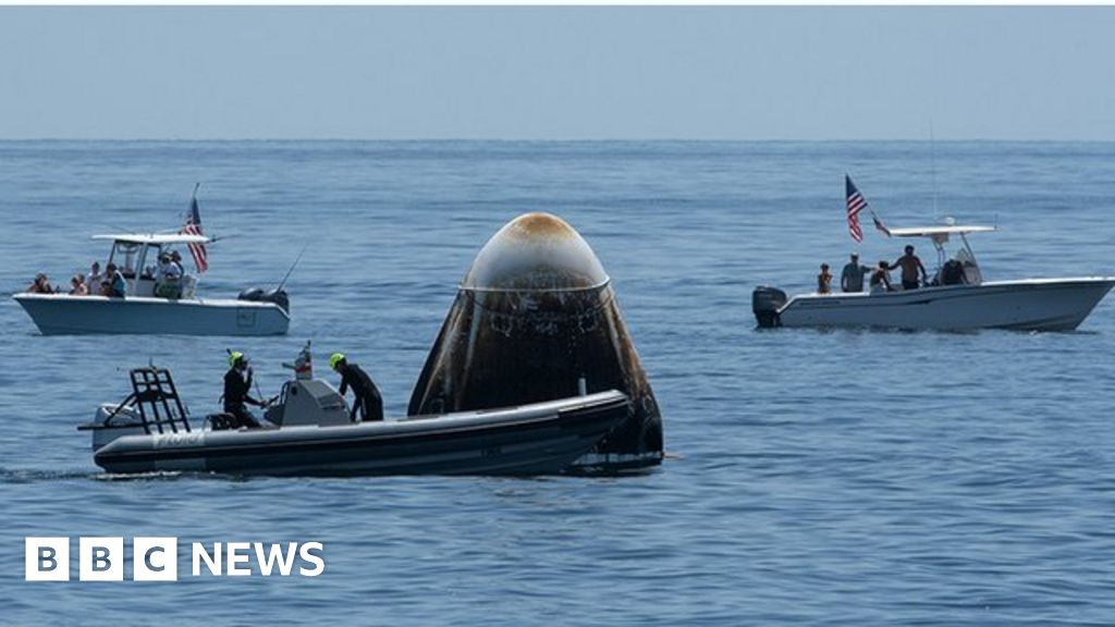 Nasa SpaceX crew return: Dragon capsule splashes down