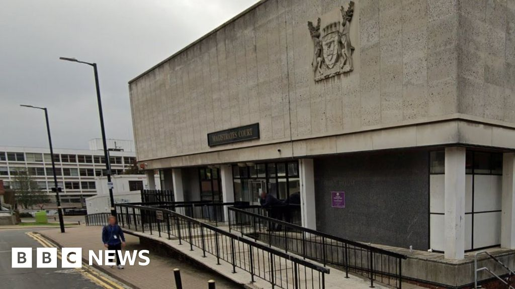 Extinction Rebellion trial delayed as accused glues hand to table
