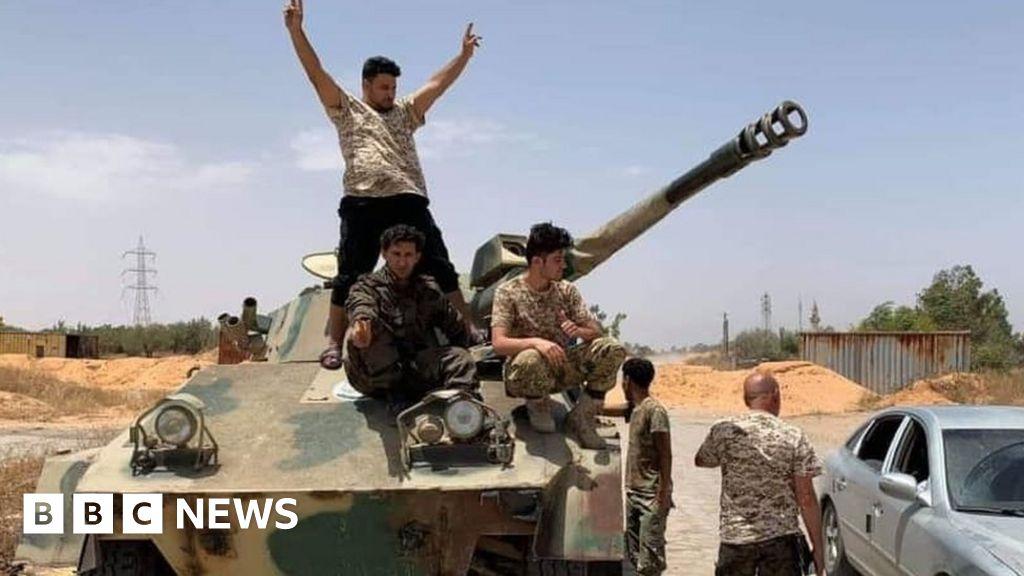 Libya rivals sign ceasefire deal in Geneva - bbc