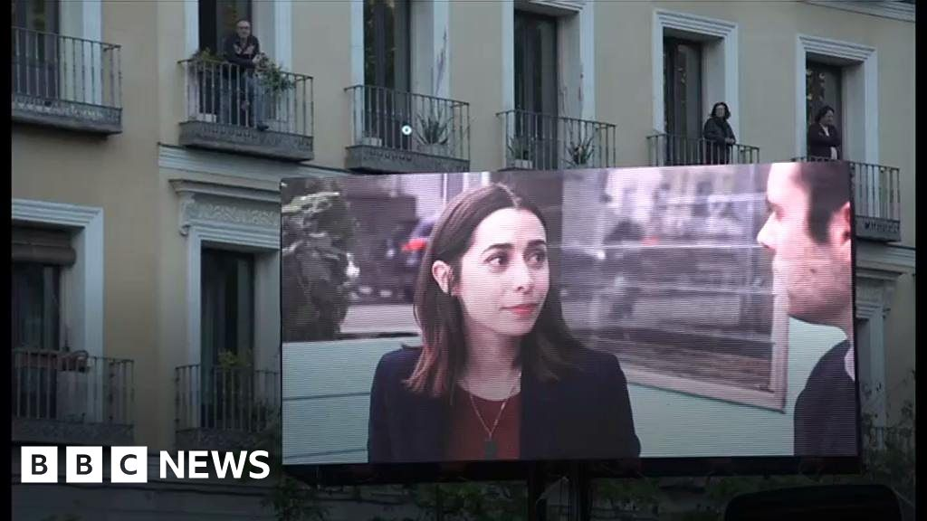 Coronavirus: Madrid's balcony cinema screens films for people in ...