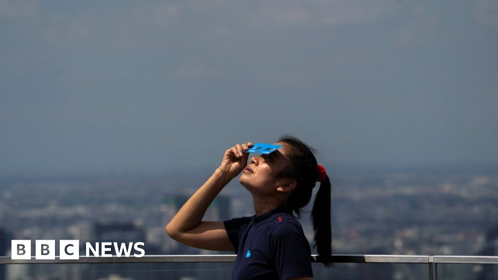 In pictures: Rare solar Eclipse in Asia darkened on the summer solstice