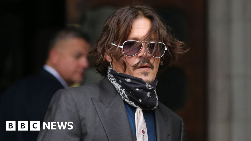 Johnny Depp denies slapping ex-wife for laughing at his tattoo