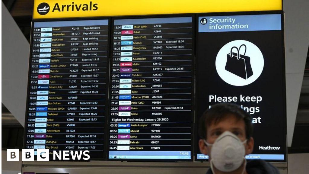 A woman arrives at Heathrow