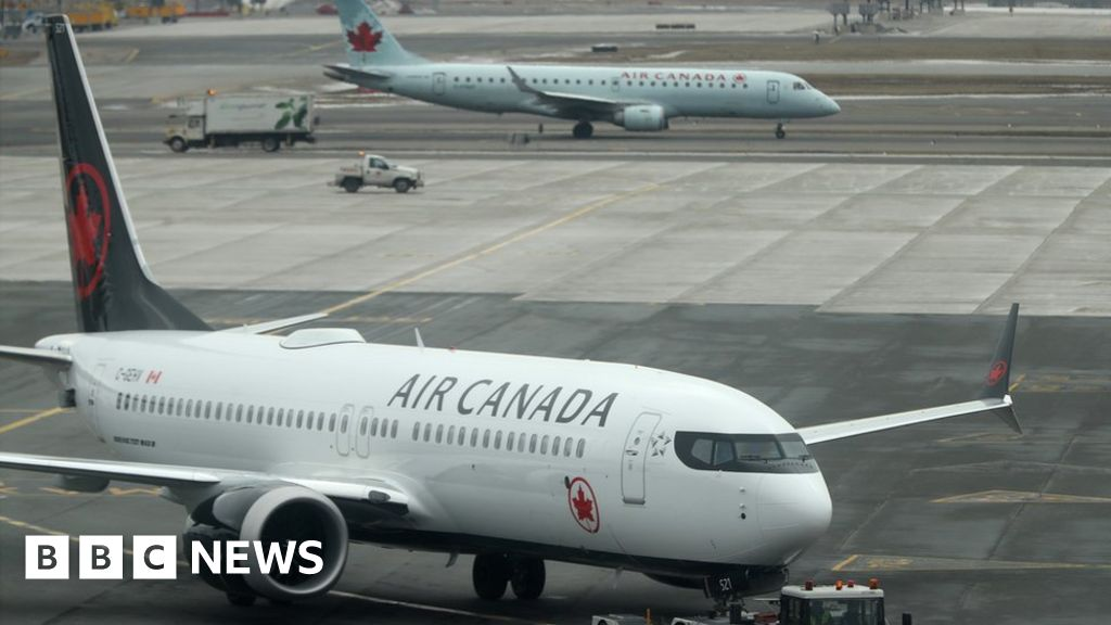 Woman left alone on board parked plane in Canada thumbnail