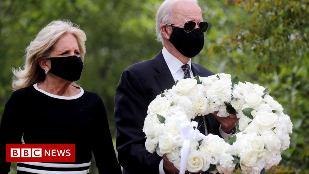 Biden emerges from quarantine on Memorial Day thumbnail