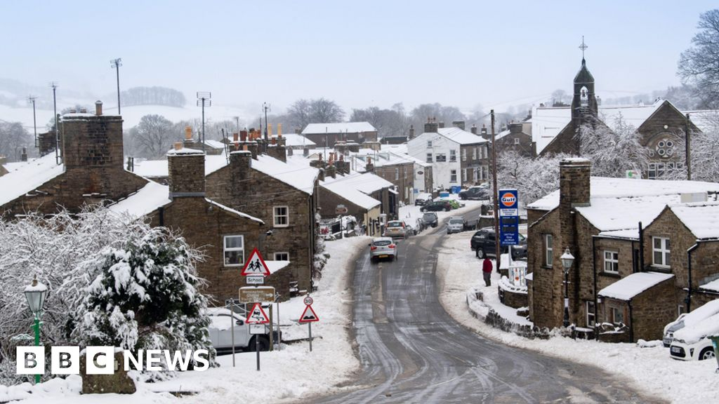 In pictures: Snowy showers hit UK
