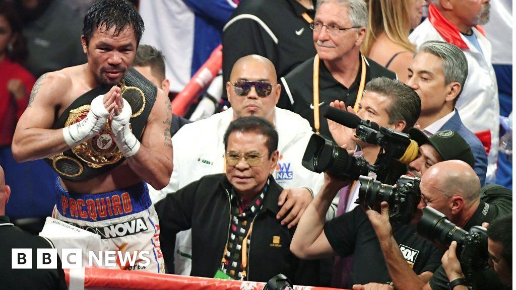 Boxing legend Manny Pacquiao swaps punching for payments - BBC News