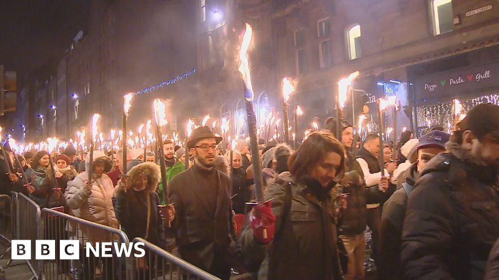 Hogmanay celebrations begin with torchlight procession