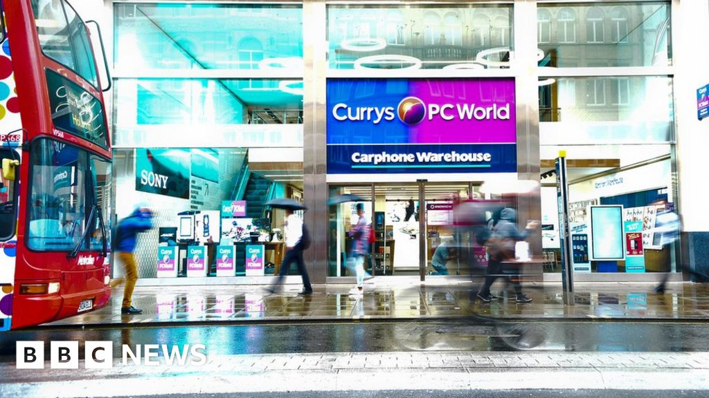 Dixons Carphone posts £440m loss in first half