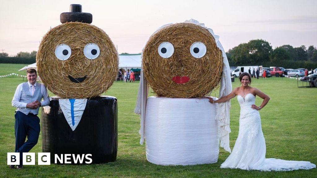 Straw bale bride and groom at Elkington farmer s wedding