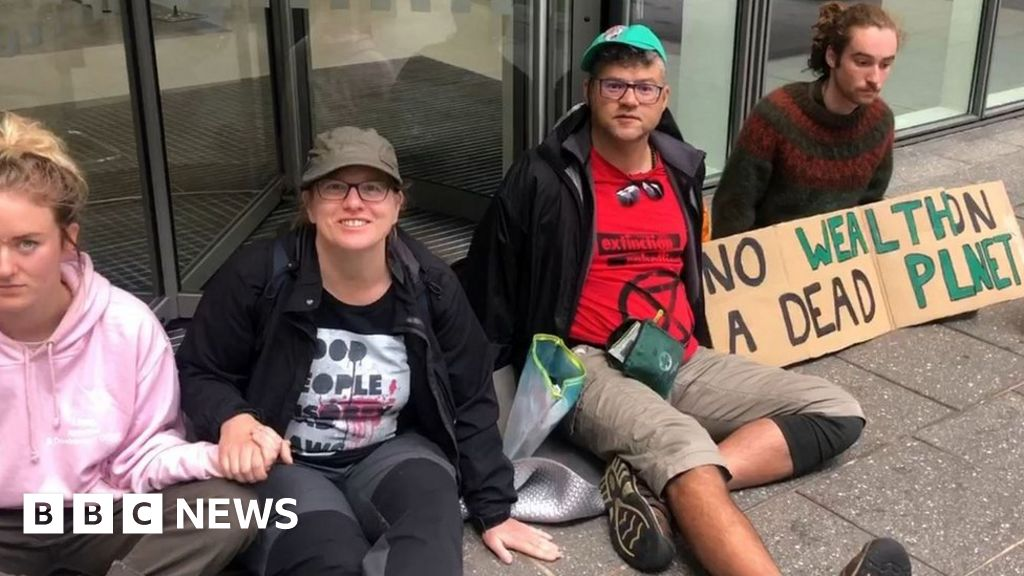 Climate activists glue themselves to bank