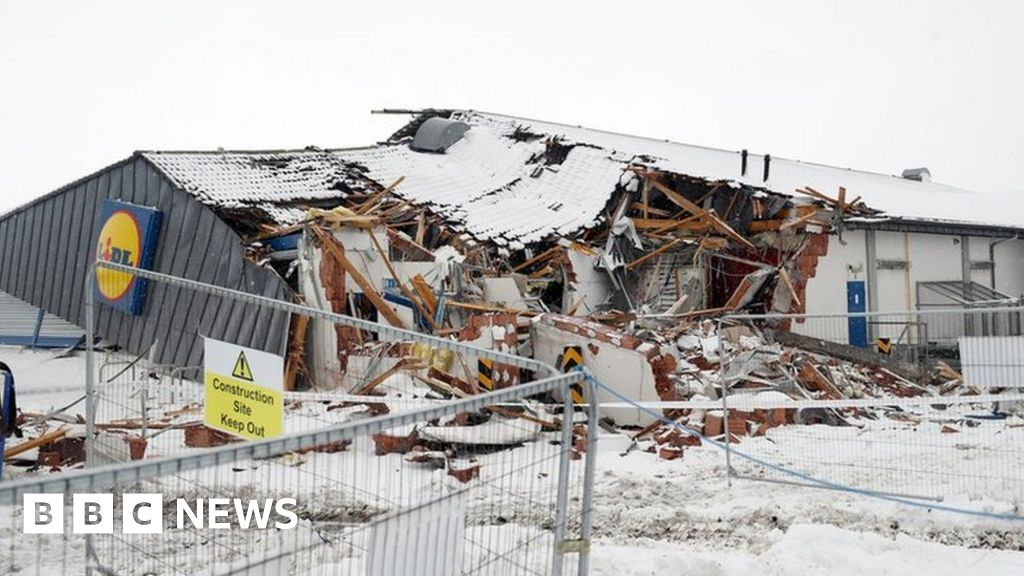 746825733e Charges after Dublin shop is  looted and bulldozed  - BBC News