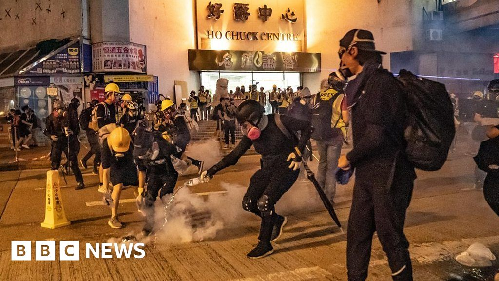 Police fire tear gas into HK railway station