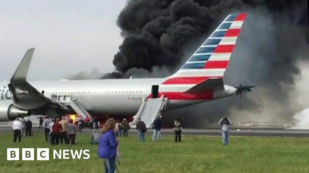 American Airlines plane catches fire on Chicago runway - BBC