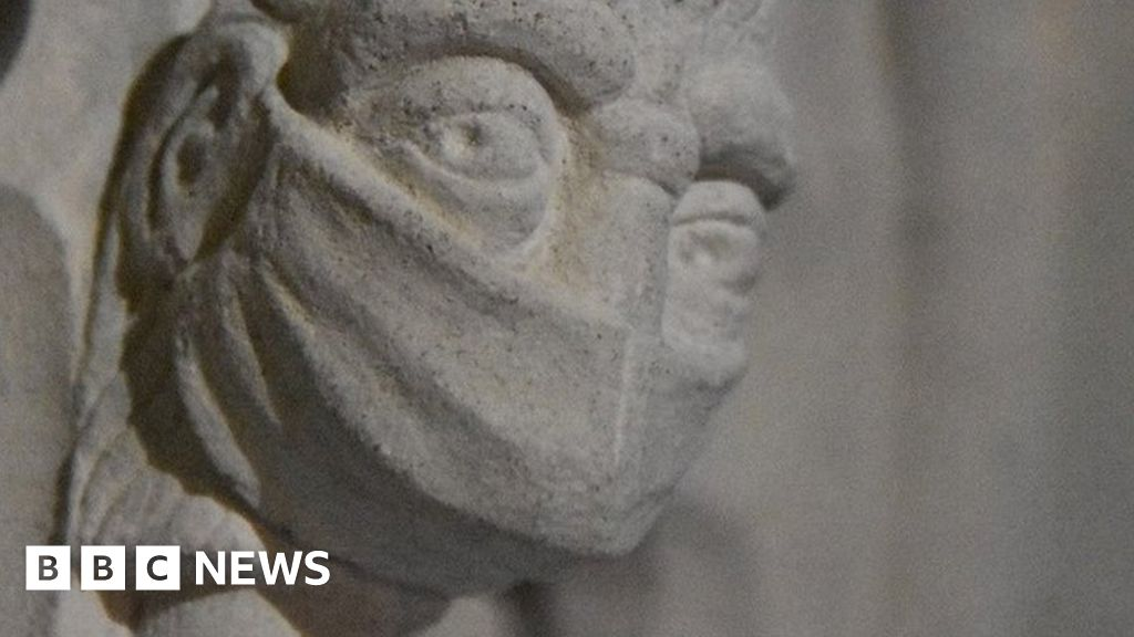 Covid: St Albans cathedral's new carving features facemask