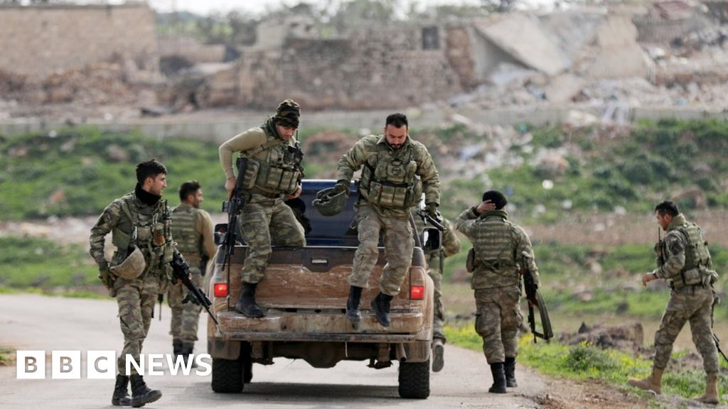 Turkish forces 'encircle' Syria's Afrin