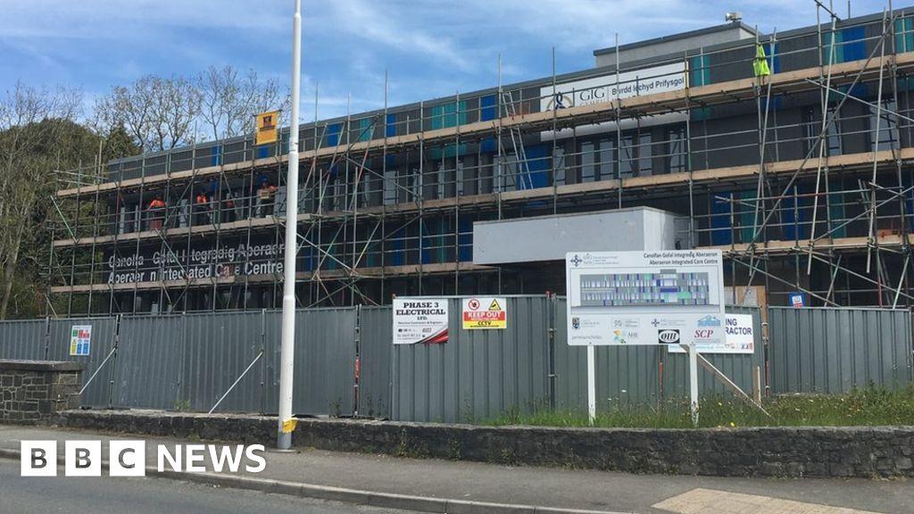 Aberaeron ambulance station backed despite flood risk - BBC News
