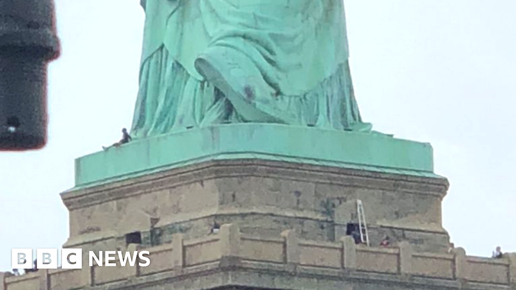 Image result for Protester climbs Statue of Liberty cnn