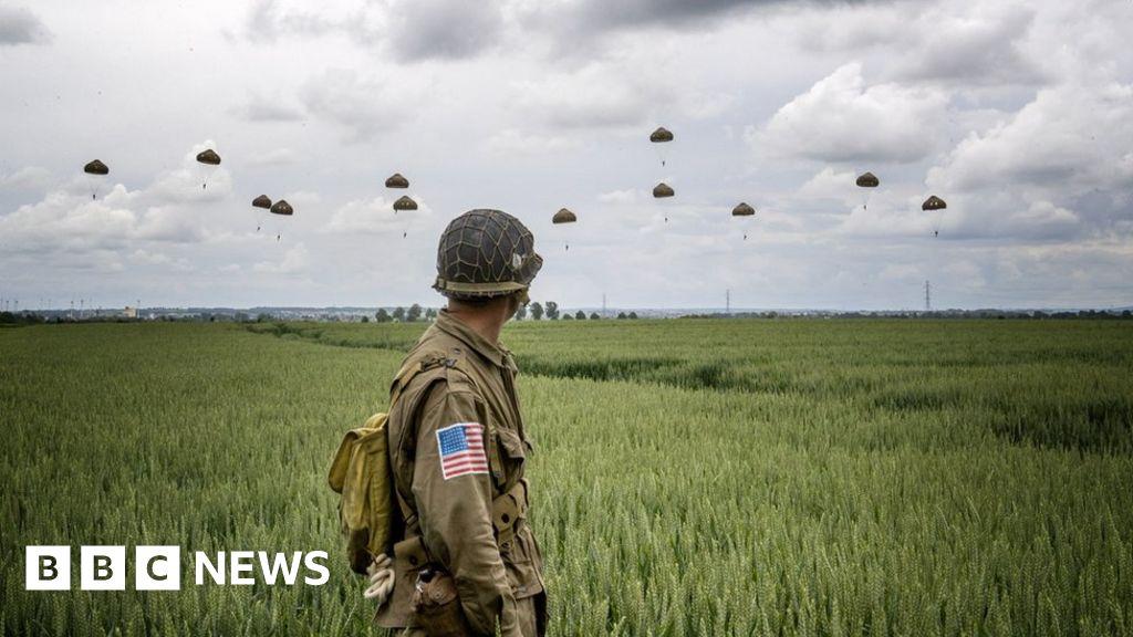 May and Macron to mark D-Day anniversary thumbnail