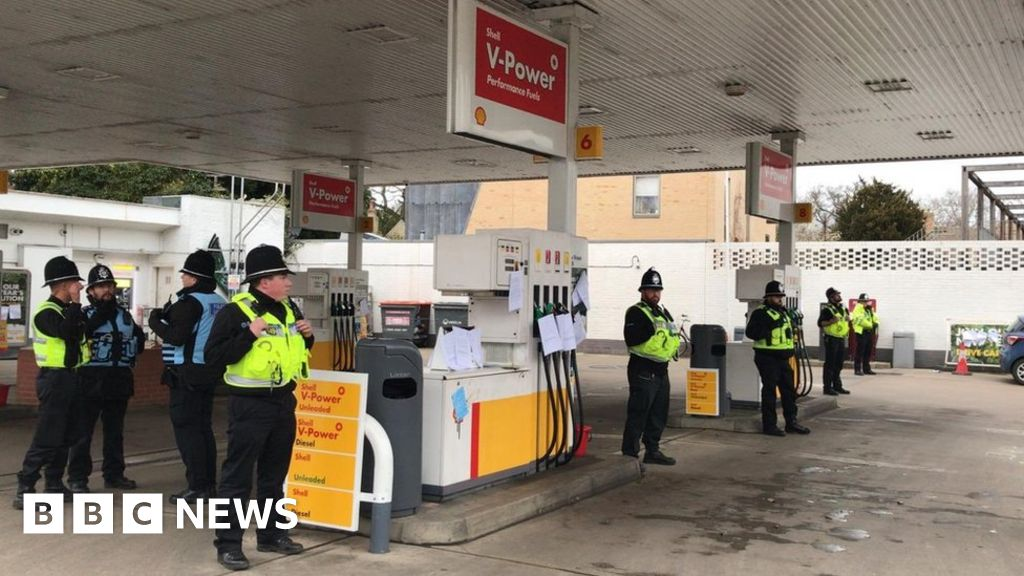 Four charged over fuel station protest