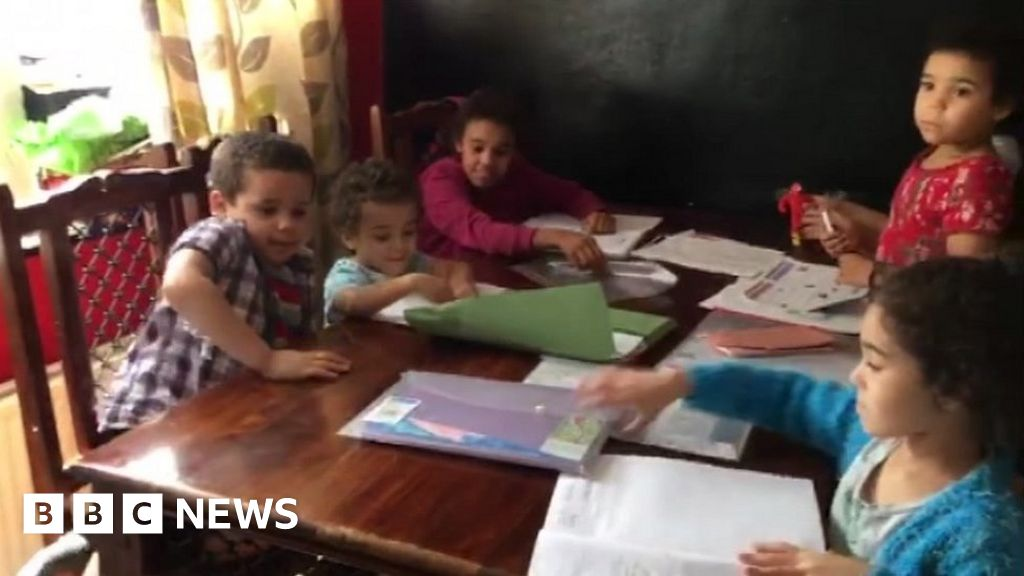 Digital divide: Six youngsters sharing one cellphone for homework thumbnail
