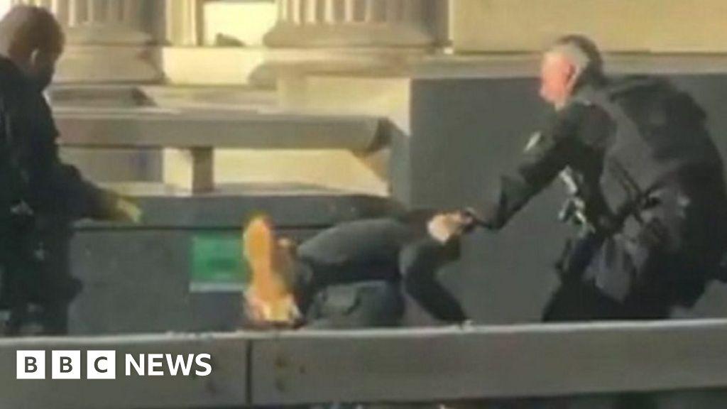 Moment man tackled on London Bridge thumbnail