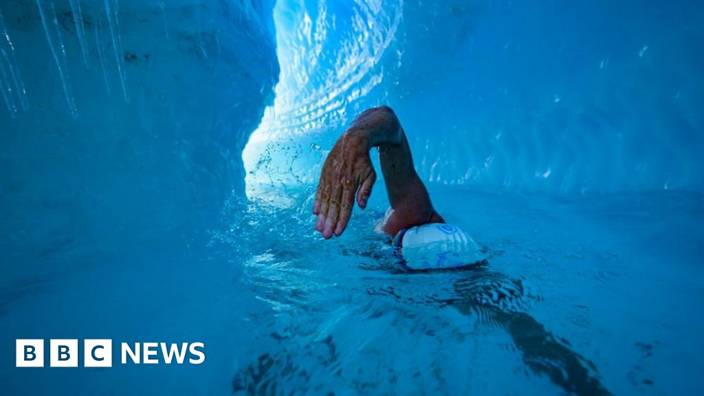 Climate activist finishes first ice sheet swim