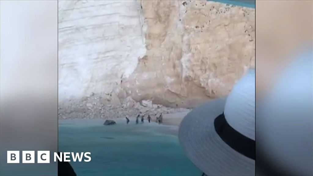 Holidaymakers film aftermath of cliff collapse