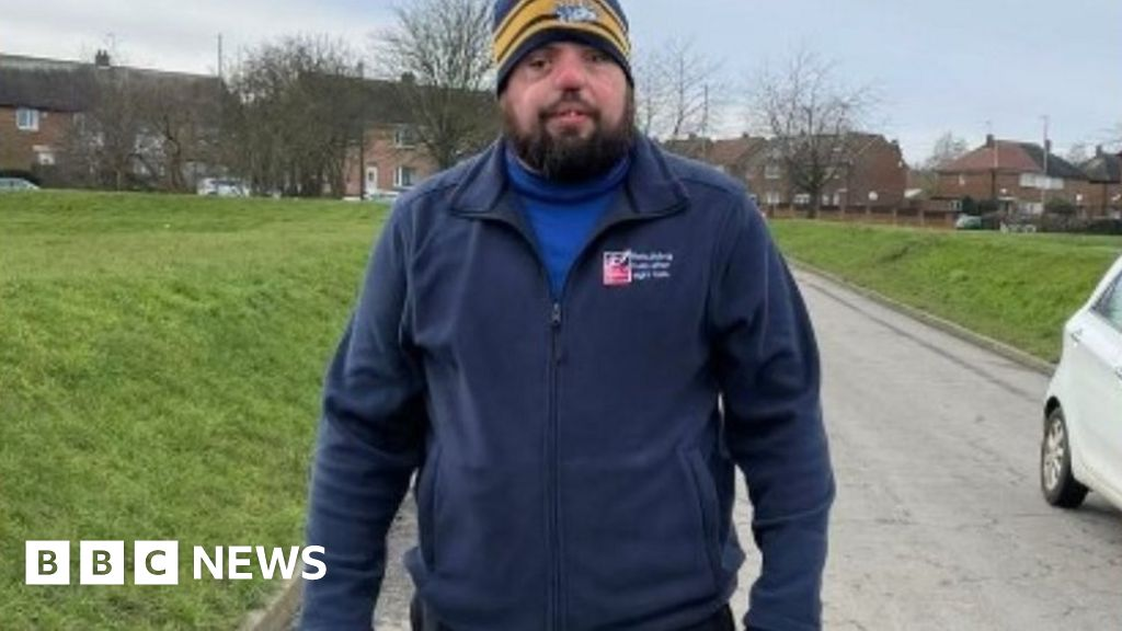 Blind veteran Simon Brown's 874-mile walking challenge