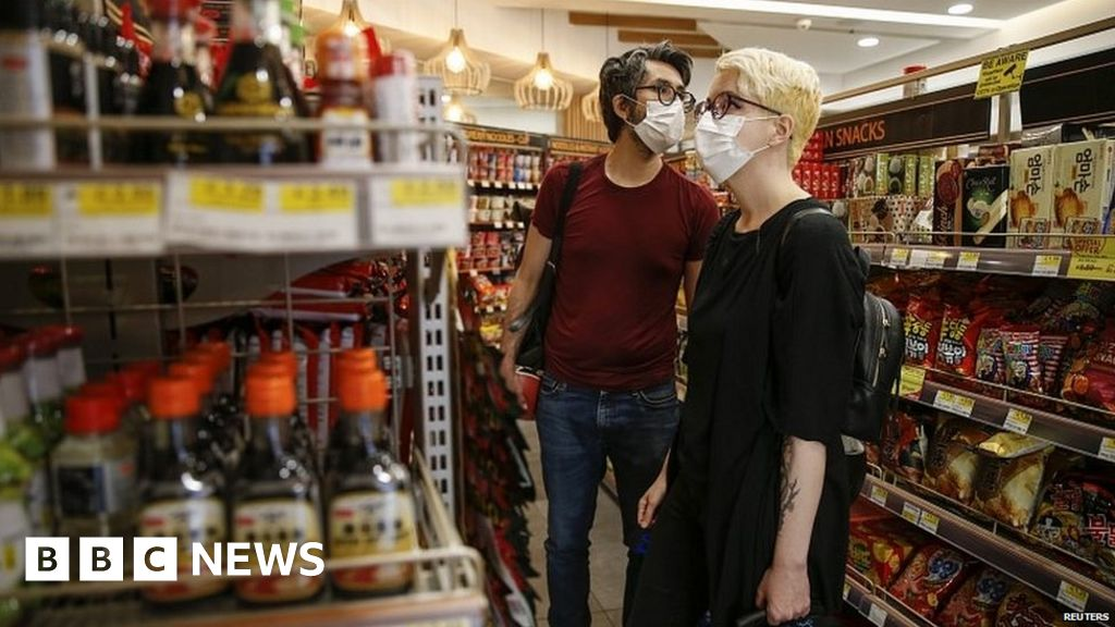 Man wearing face mask in a shop in London