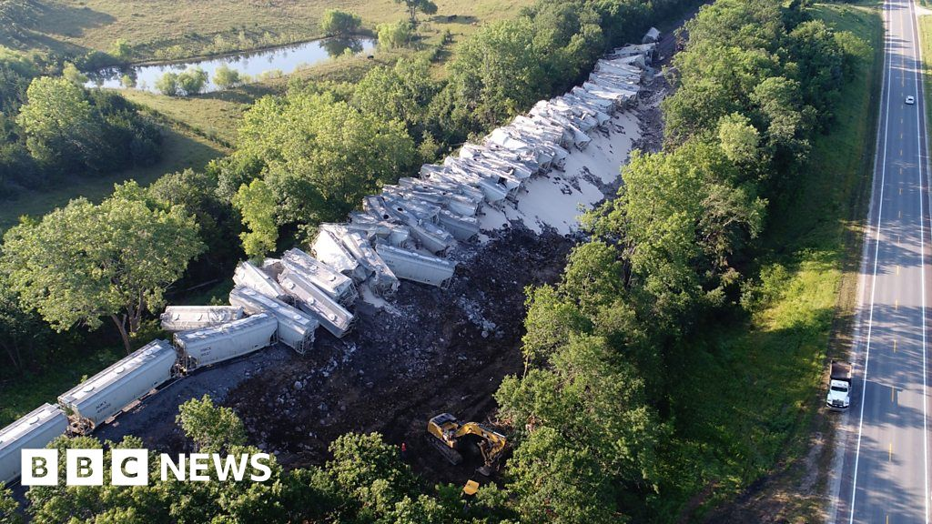 Drone footage shows the Florida-bound train with dozens of cars hanging off the rails in Missouri.