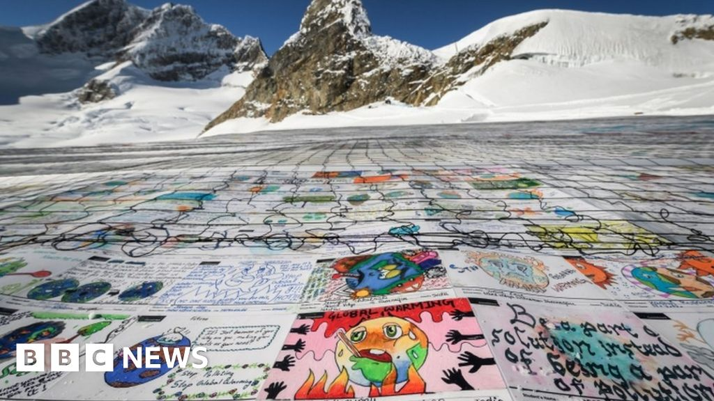 Shrinking Swiss glacier hosts world's largest postcard