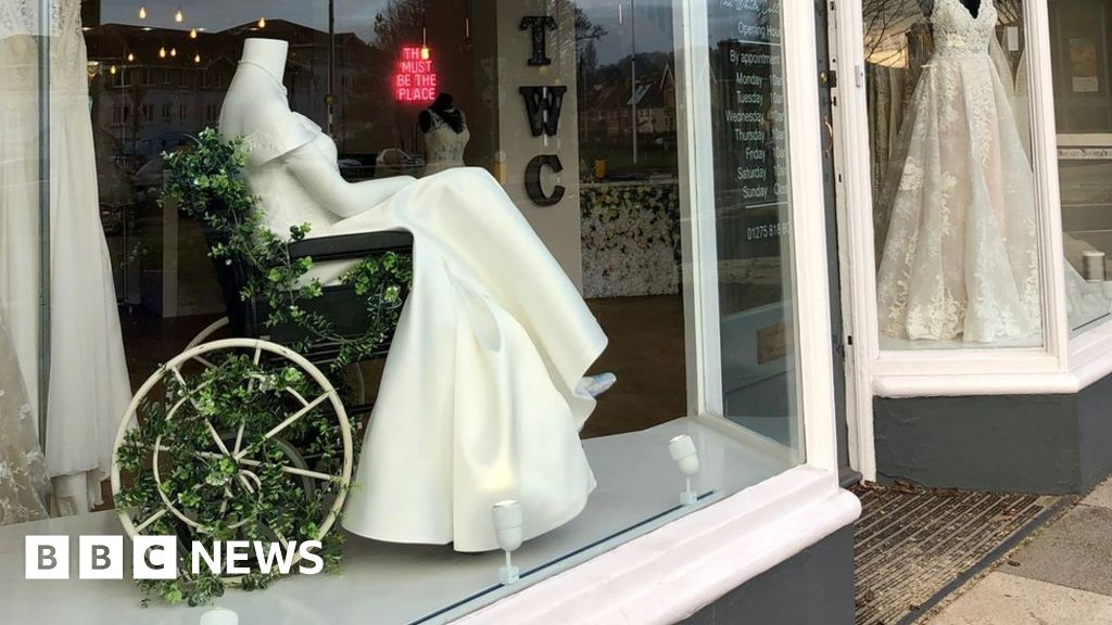 The White Collection displays a gown on a mannequin in a wheelchair in its store in North Somerset