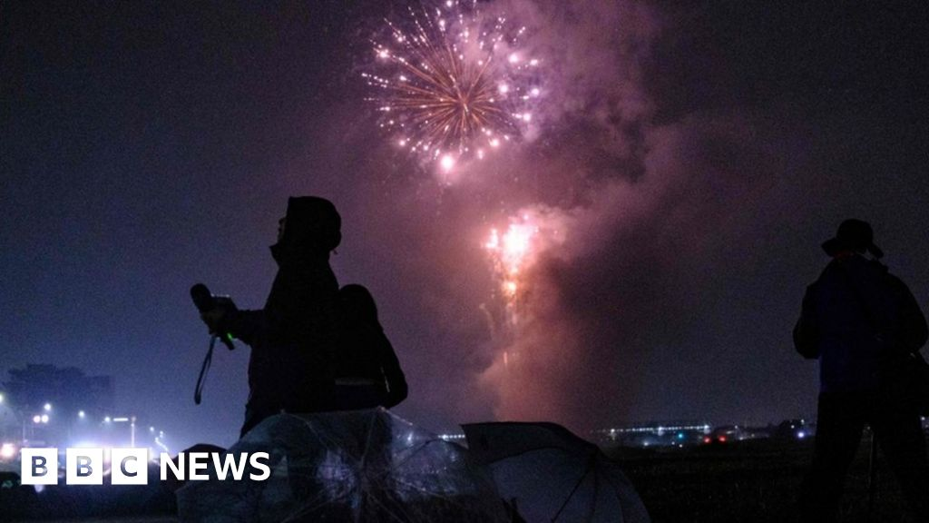 Japan lightens mood with surprise fireworks