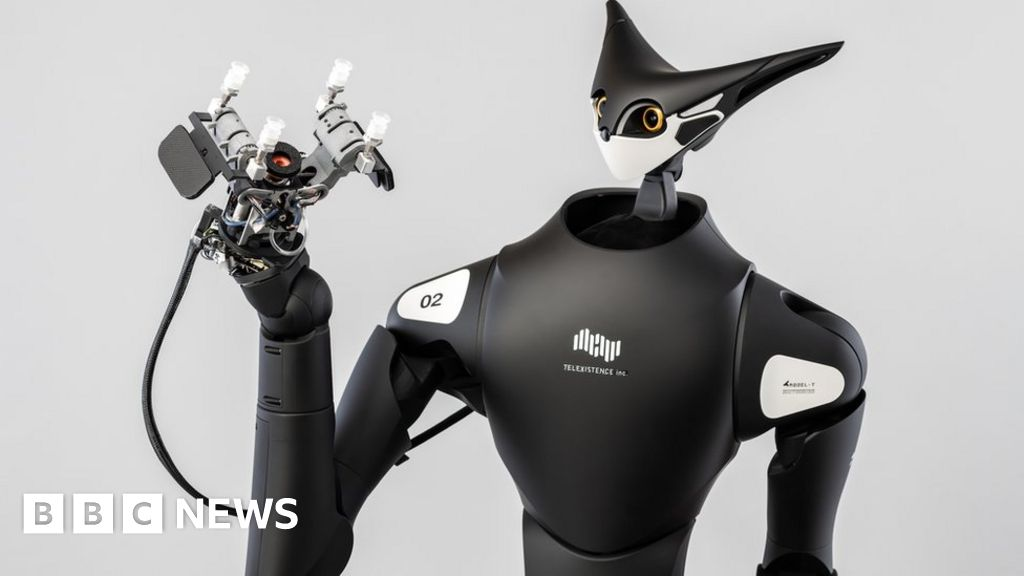 The robot shop worker controlled by a faraway human