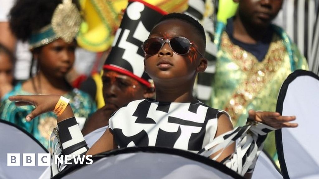 Notting Hill Carnival: Revellers swelter in record heat