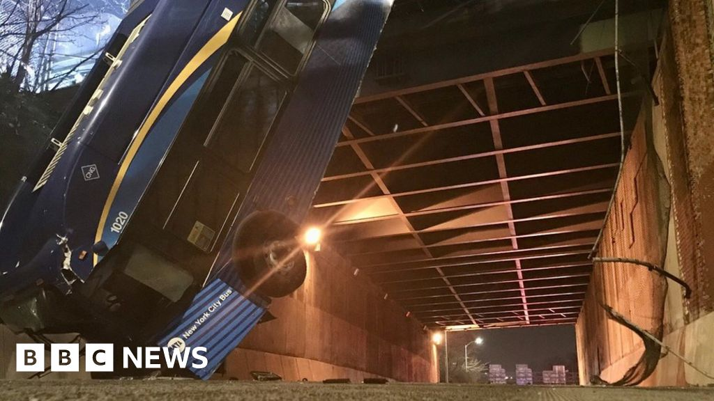 NYC bendy bus left drooping from overpass in Bronx