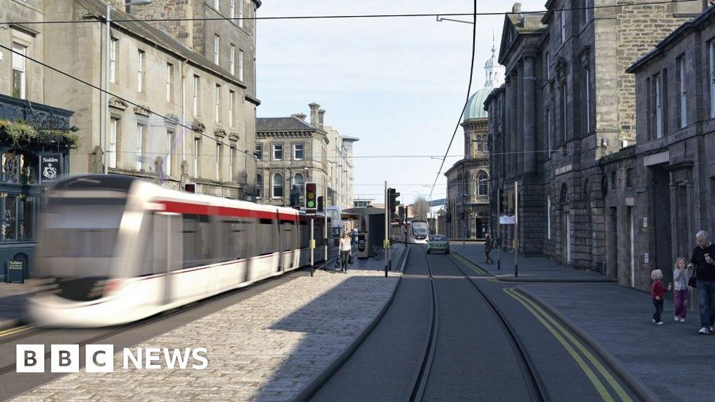 Tram passing Scott's Monument in Edinburgh