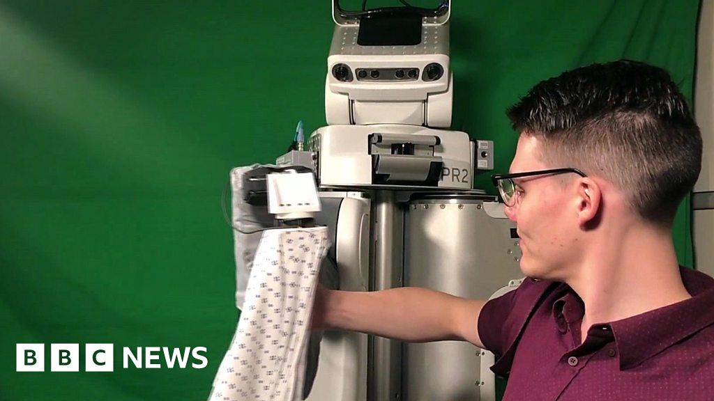 Robot helps patients put on hospital gown and other news - BBC News