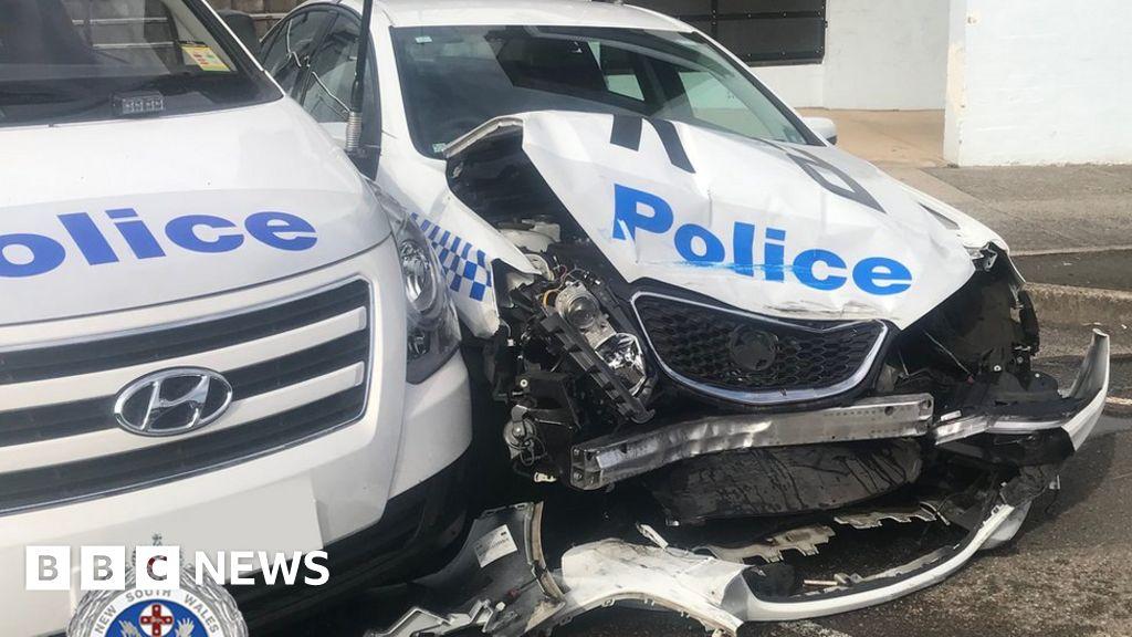 Australia drug runner crashes van into police car