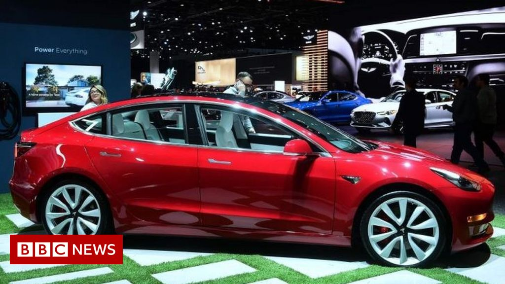 Tesla reports $702m quarterly loss