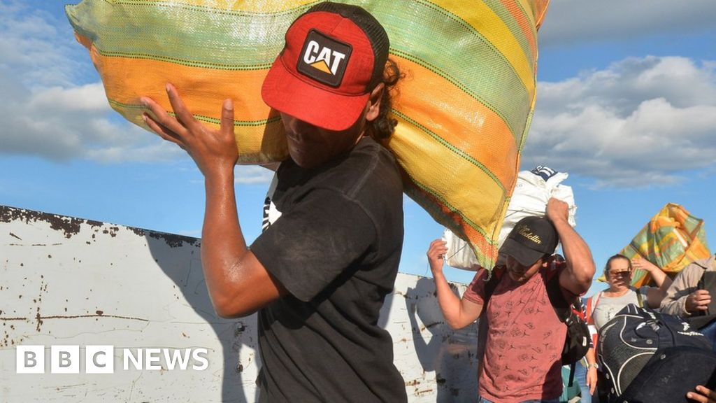 Venezuelans cross into Colombia as border reopens