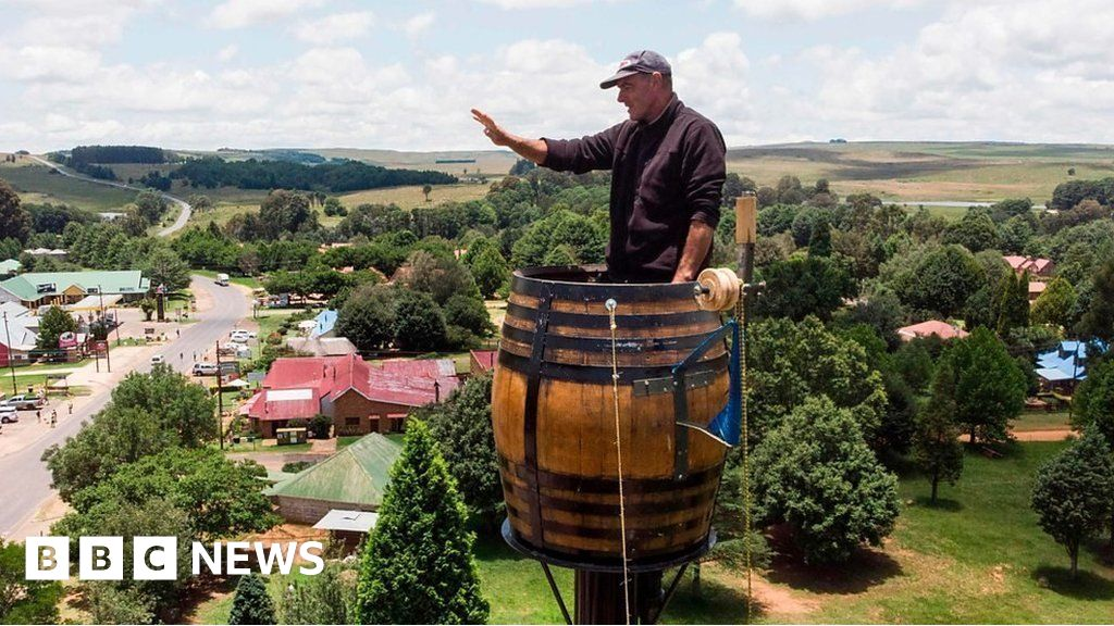 South African man breaks own barrel sitting record - BBC News