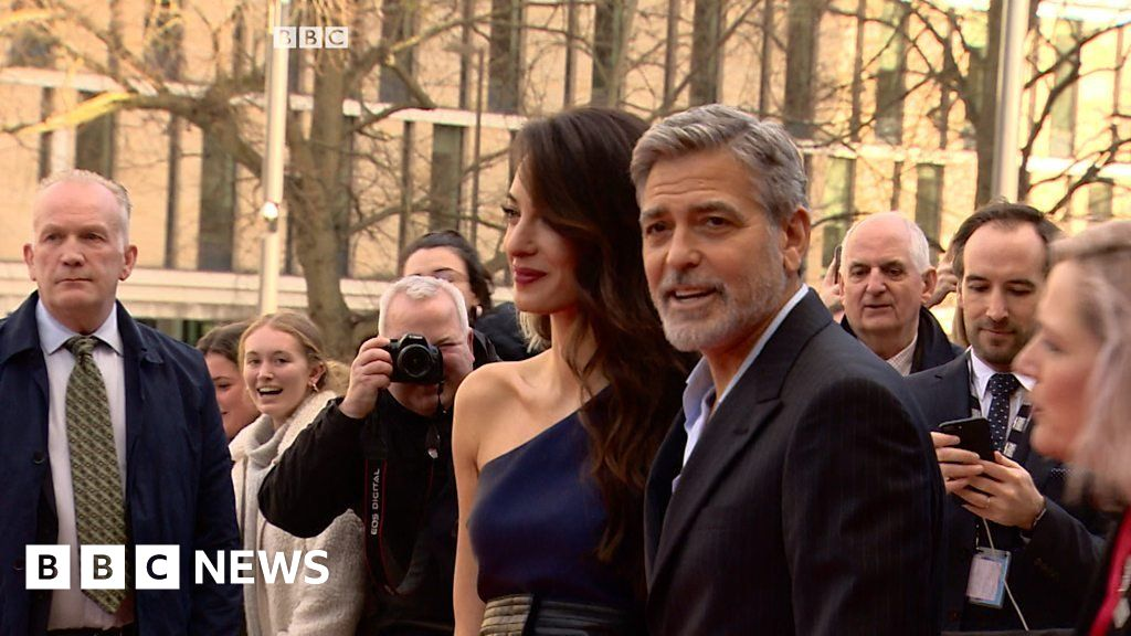 George and Amal Clooney shiver in Scotland