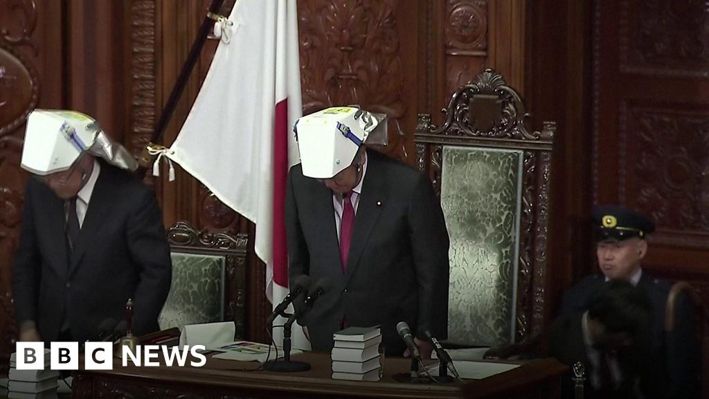 Japan MPs try on their earthquake helmets thumbnail