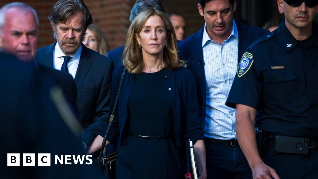 Actress Felicity Huffman begins 14-day jail term for cheating scam