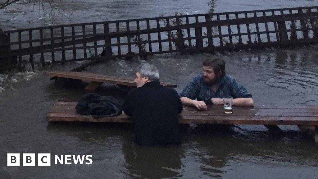 Leeds pub garden floods, men go for pint anyway