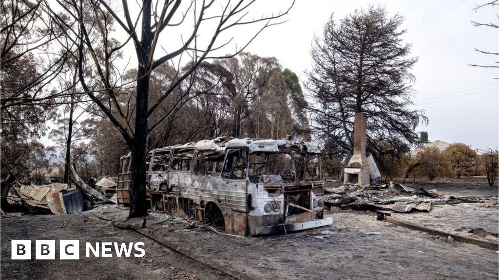 Australia Bush fire crews battle mega blaze in the vicinity of the snow-capped mountains