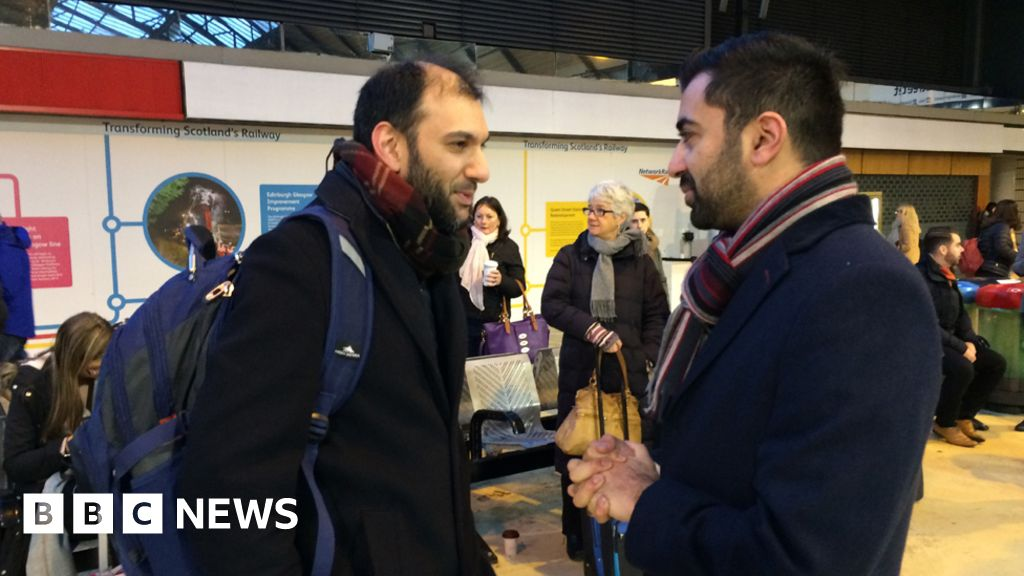 Humza Yousaf talking to passengers